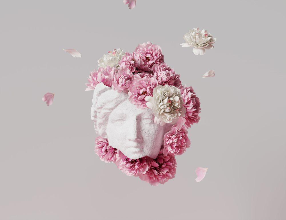 Romersk byste omgitt av rosa blomster
